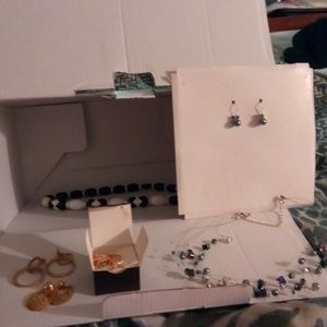 Several different pieces of earrings/necklaces